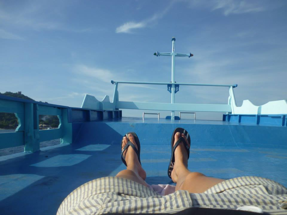 Relaxing in the sun, on the top of Crystal Dive Schools dive boat in Koh Tao, Thailand