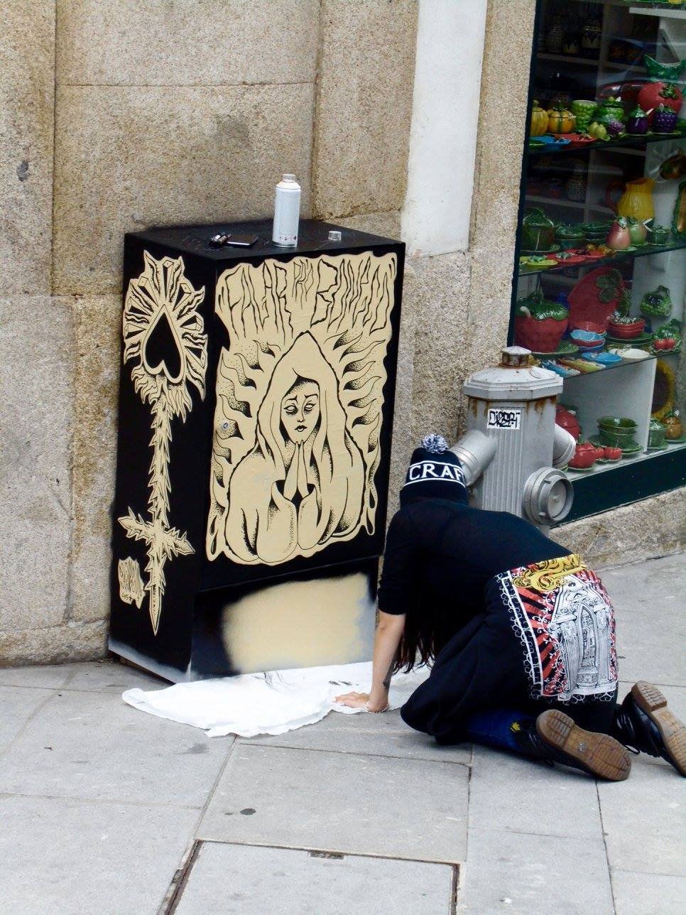 A street artist at work in Porto, Portugal