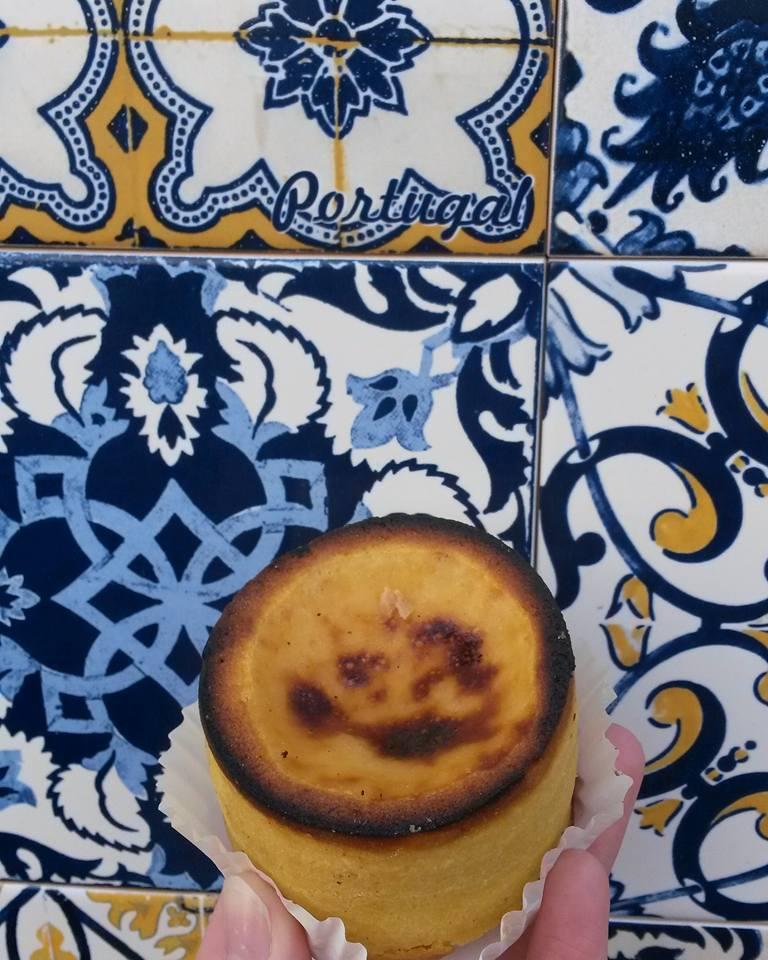 The national pastry called Pastal De Nata, as sampled in Porto, Portugal