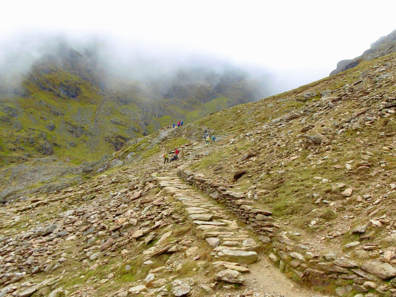 Looking up toward the summit of Snowdon, with low cloud hanging around.