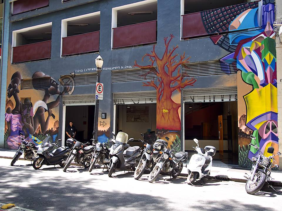 Street art and bikes line up along a street in Sao Paulo