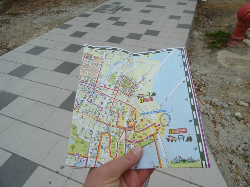 Touring Singapore on foot in 2014 with a map and a bottle of water